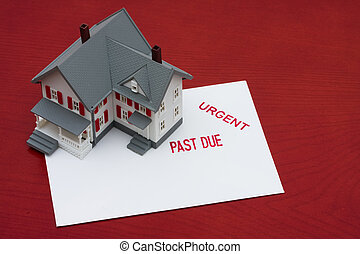 Overdue Mortgage - An overdue bill beside a house on red...