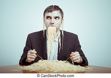 Overeating and consumerism concept. Silly nasty businessman eating pasta.