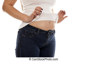 overeating woman - the woman shows her stomach that has...