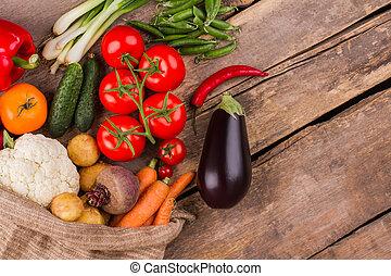 Overfilled sack of vegetables.