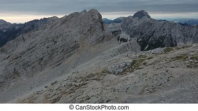 Overflight of mountain ridge and peaks. Mojstrovka in Julian...