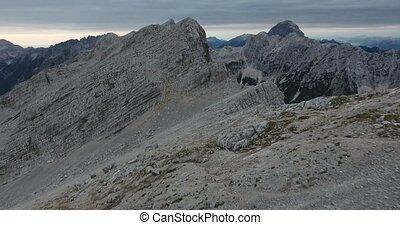 Overflight of mountain ridge and peaks. Mojstrovka in Julian...