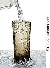 overflow - glass of a water with overflow on white...