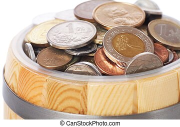 overflowing barrel with various coins
