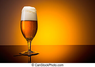 overflowing beer glass - A glass of overflowing beer on...