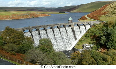 Above the overflowing Craig Goch dam, Elan Valley Wales UK.