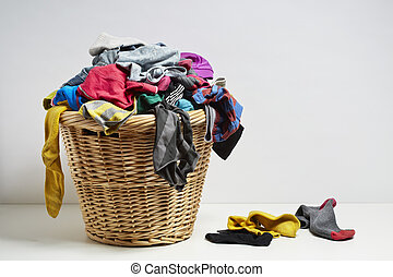 Overflowing laundry basket. Household chore concept on white...