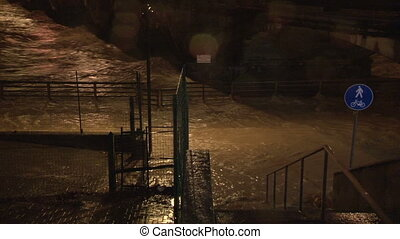 Overflowing river dangerously reaching alert level during...