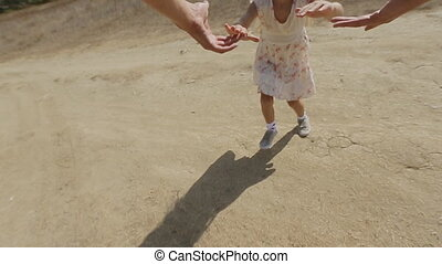 Overflowing with emotions little girl is whirled by dad in...