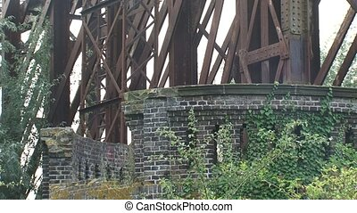 overgrown remains of a truss bridge
