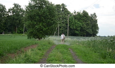 overgrown road grass mow - overgrown rural road and farmer...