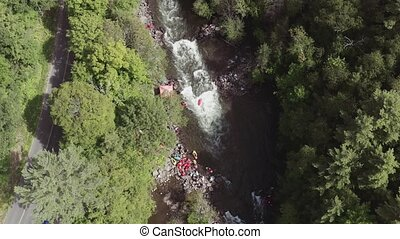 Overhead Aerial Shot of Kayakers on River with Rapids....