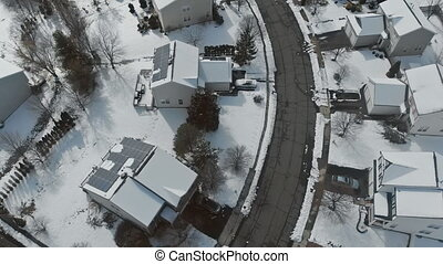 Overhead aerial view of residential houses and village houses covered in snow