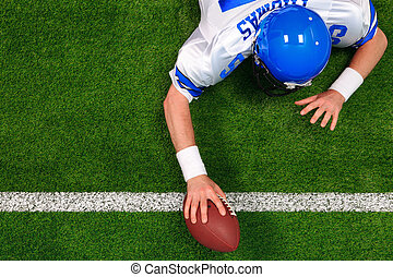 Overhead American football player one handed touchdown -...