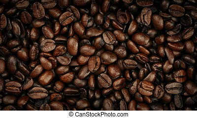 Overhead Closeup Shot Of Coffee Beans Turning Slowly - Macro...
