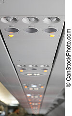 Overhead console in the modern passenger aircraft aeroplane air conditioner and light panel