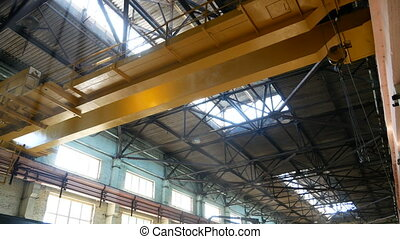 Overhead crane moves in a large factory - Overhead crane...