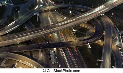 Overhead flyover the complex road junction highway. Night...