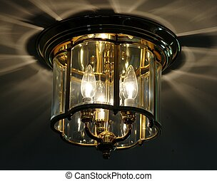 OVERHEAD LIGHT FIXTURE - An overhead light fixture featuring...