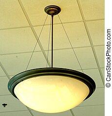 OVERHEAD LIGHT - An incandescent overhead light hanging from...