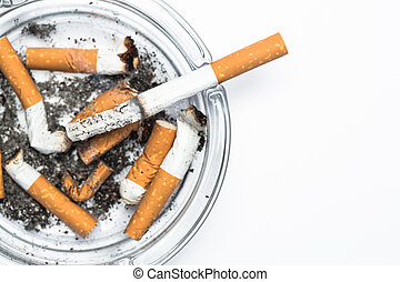 Overhead of burning cigarette in ashtray with copy space