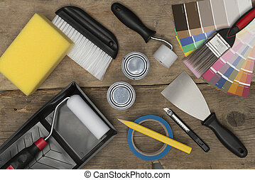 Overhead of Home Improvement Painting Equipment on Wooden Surface
