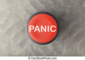 Overhead of Red Panic Button Over Blurred Gray Background