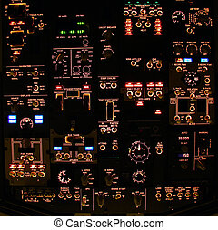 Overhead panel - Flight deck of a modern airliner at night.