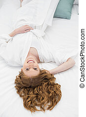 Overhead portrait of pretty woman resting in bed