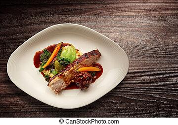 Overhead shot of a gourmet plate of sliced roast pork
