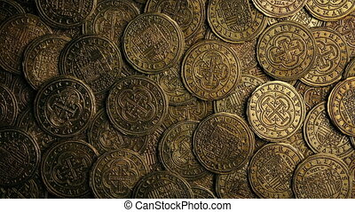Closeup of very old gold coins rotating