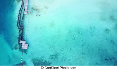 Overhead shot of crystal clear waters on a relaxing beautiful beach