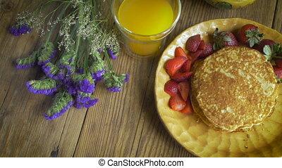 Overhead shot of gourmet breakfast of strawberries, orange...
