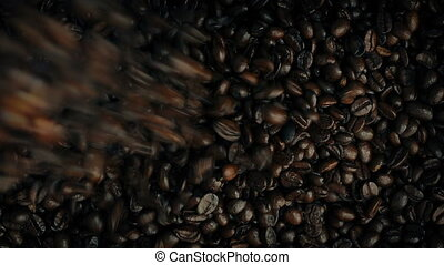 Overhead Shot Of Roasted Coffee Beans Poured Into Pile -...