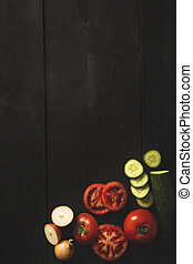Overhead shot with vegetables on a black background
