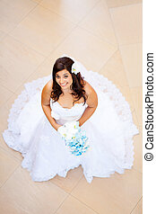 overhead view of a beautiful bride in wedding dress