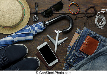 Overhead view of accessories fashion men clothing with technology concept background. Mix variety object on modern rustic wooden office desk. Essential items for teenage or adult and traveler to trip.