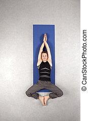 man practicing yoga on mat - Overhead view of caucasian man...