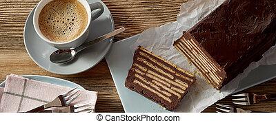 Overhead view of chocolate cake and coffee