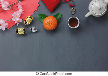 Overhead view of decorations Chinese & lunar New Year concept background.many objects is sign of the season.items on classic grey grunge home table.Other language means wealthy or rich and happiness.