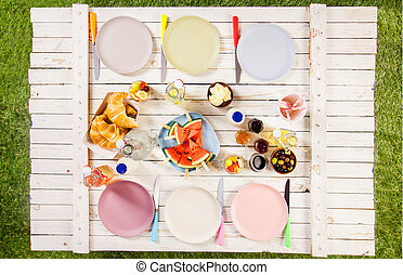 Overhead view of food on a summer picnic table