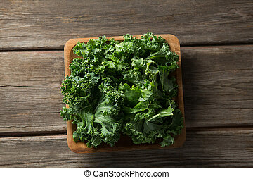Overhead view of fresh kale on table