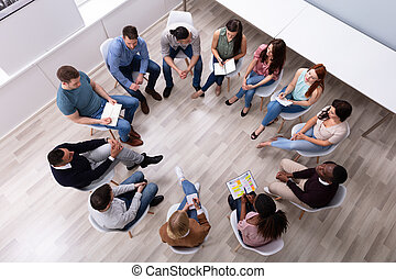 Overhead View Of Friend Sitting In Circle