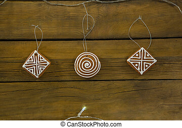 Overhead view of gingerbread cookies on wooden table
