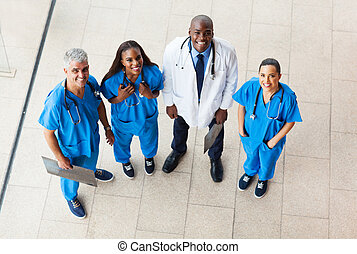 overhead view of group healthcare workers looking up