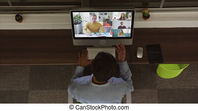 Overhead view of man having a video conference