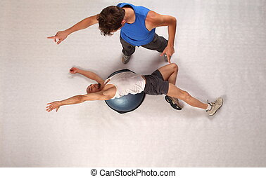 man training with personal trainer