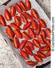 Overhead view of roasted Roma tomatoes