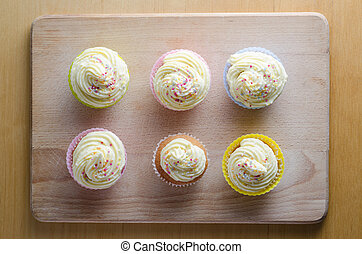 Overhead View of Six Decorated Cupcakes