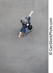overhead view of teen boy skateboarding